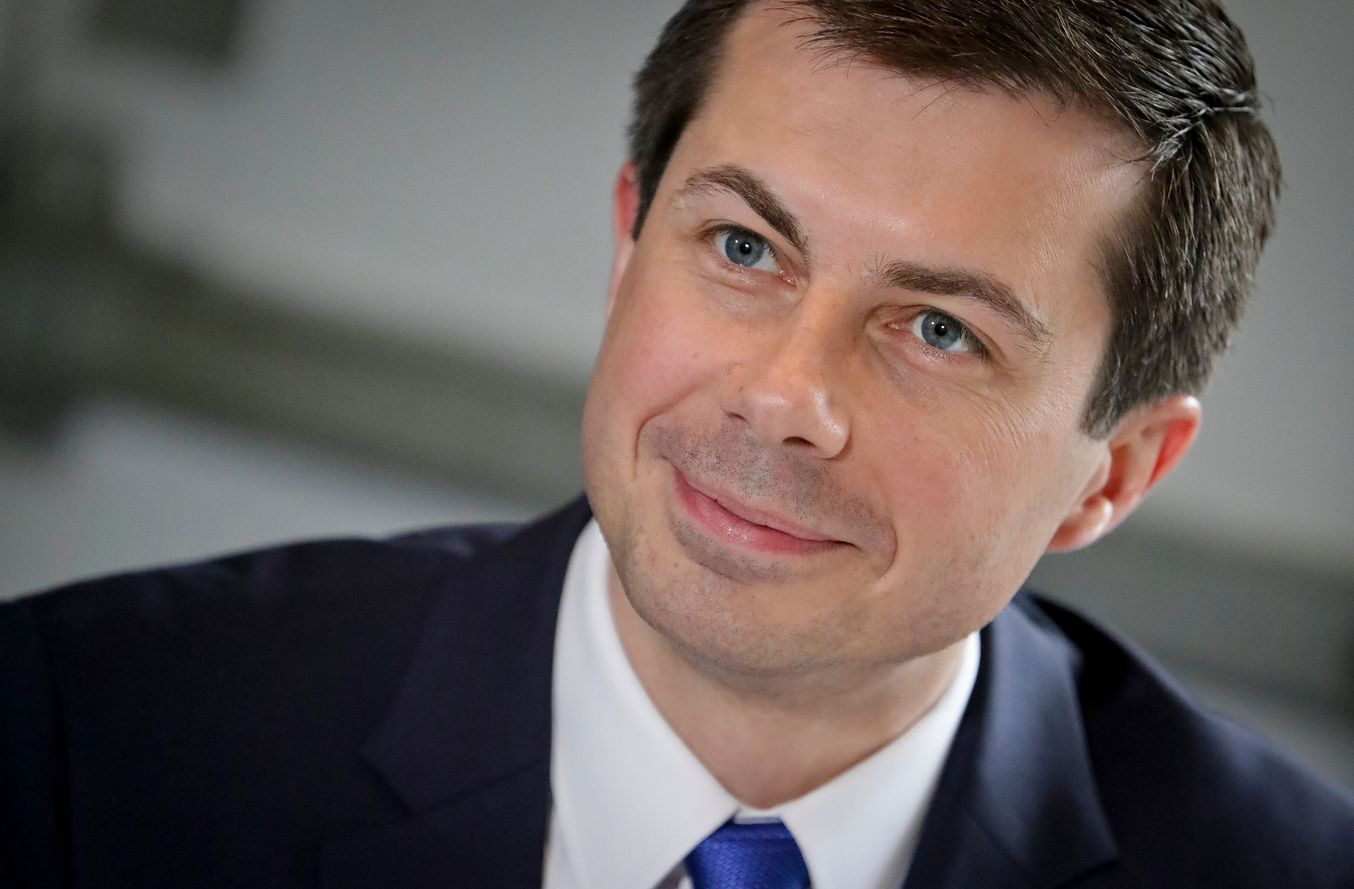 In this April 29, 2019, photo, Democratic presidential candidate Mayor Pete Buttigieg, from South Bend, Ind.,, listens during a lunch meeting with civil rights leader Rev. Al Sharpton at Sylvia's Restaurant in Harlem neighborhood of New York. Buttigieg is making a new, concerted effort to appeal to African American voters and put behind him criticism of his record on race.  (AP Photo/Bebeto Matthews, Pool)