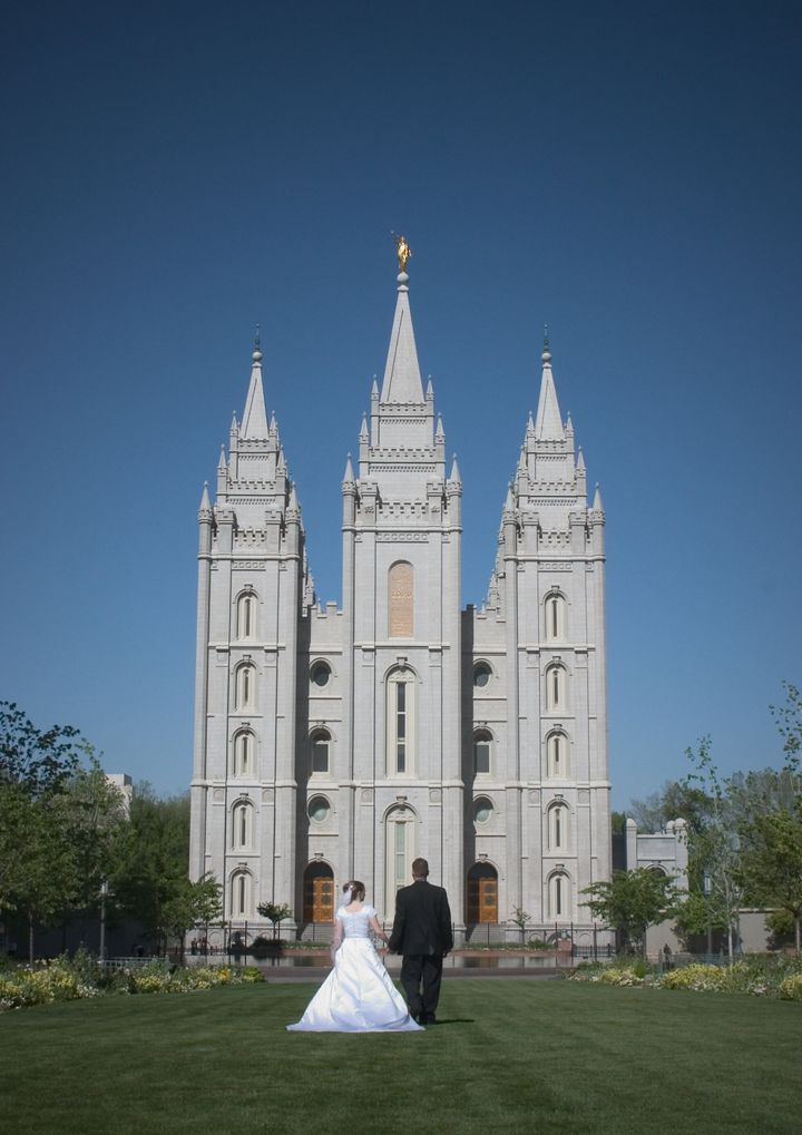 A couple poses outside the Salt Lake City temple in Utah.