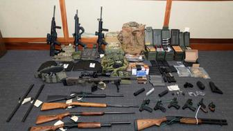 FILE - This undated file image provided by the U.S. District Court in Maryland shows a photo of firearms and ammunition that was in the motion for detention pending trial in the case against Christopher Hasson. A defense attorney has proposed several pretrial release options for U.S. Magistrate Judge Charles Day to consider during a detention hearing, Tuesday, May 7, 2019, in Maryland for Hasson. (U.S. District Court via AP, File)