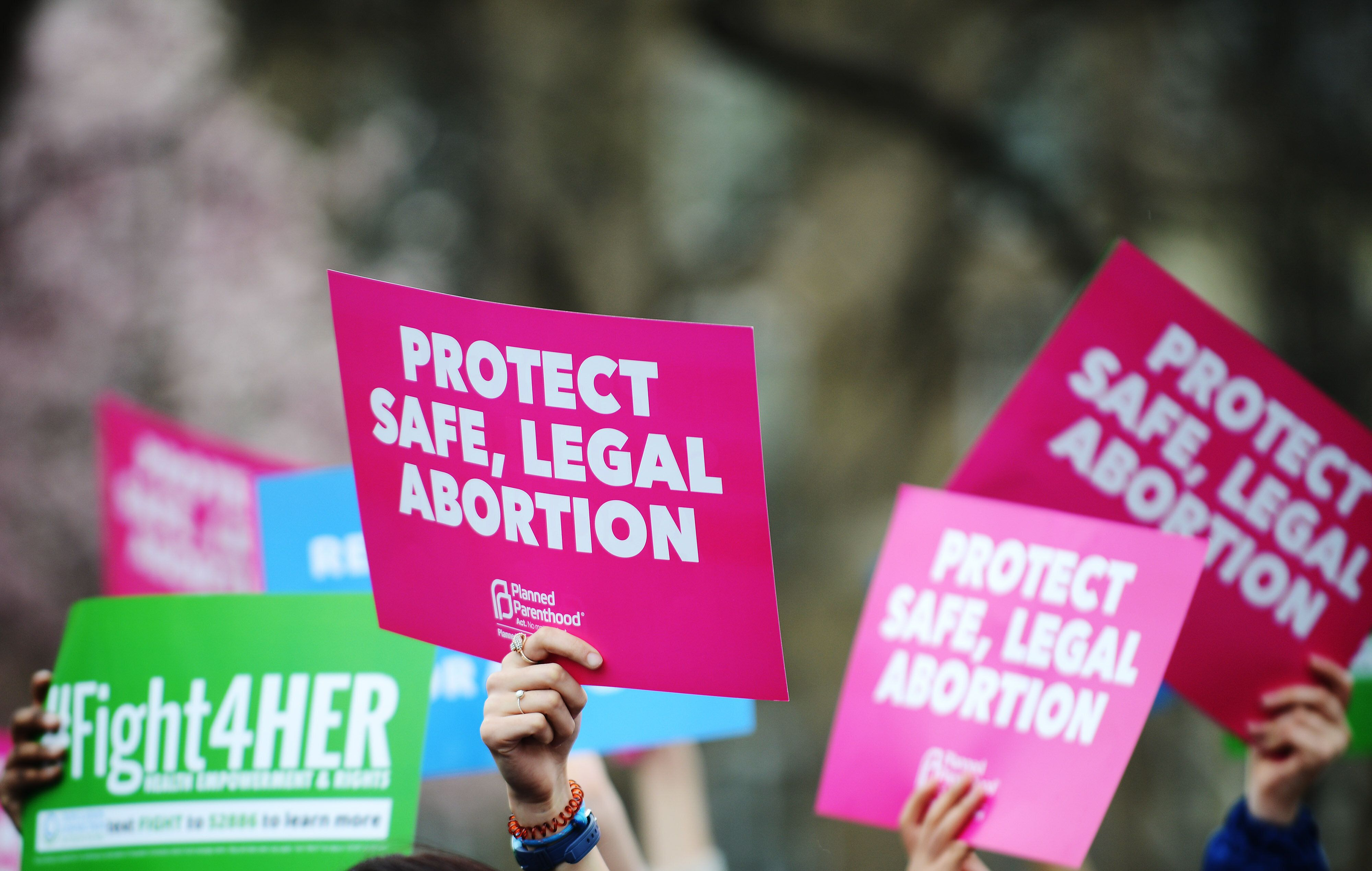 """WASHINGTON, DC - MARCH 29: People attend a """"Fight4Her"""" pro-choice rally in front of the White House at Lafayette Square on March 29, 2019 in Washington, DC. A coalition of NARAL Pro-Choice America, Planned Parenthood and Population Connection Action Fund gathered to demand the end of the 'Global Gag Rule'.  (Photo by Astrid Riecken/Getty Images)"""