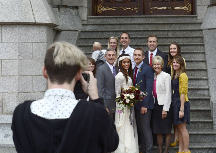 A couple poses for a photograph with members of their wedding party on Sept. 27, 2014, after their wedding ceremony inside th