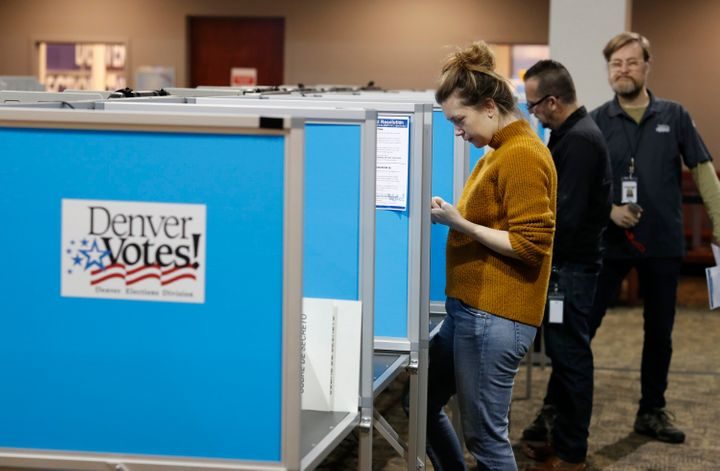 Voters fill out their ballots at the Denver Elections Division Tuesday, May 7, 2019, in Denver.
