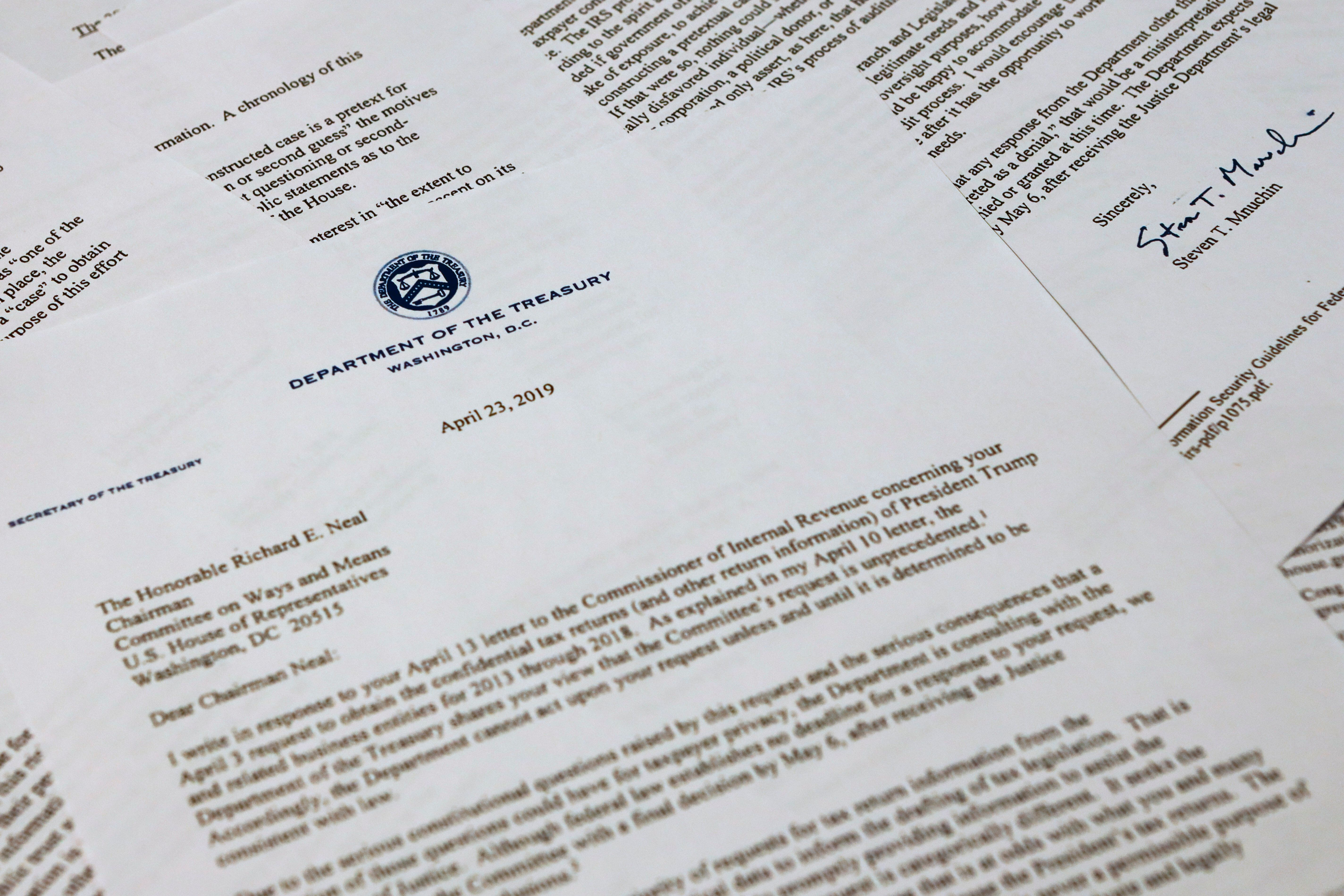 The letter from Treasury Secretary Steven Mnuchin to House Ways and Mean chairman Richard Neal of Mass., is photographed Tuesday, April 23, 2019, in Washington. Mnuchin is asking for more time to respond to House Democrats' request for President Donald Trump's tax returns.  (AP Photo/Jon Elswick)