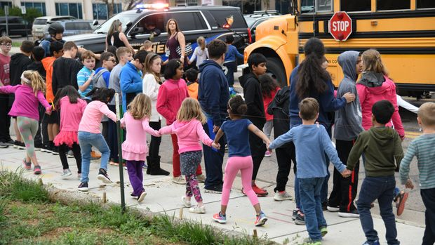 HIGHLANDS RANCH, CO - May 7: Students escorted school bus in front of STEM School Highlands Ranch after a shooting. May 7, 2019. (Photo by Hyoung Chang/MediaNews Group/The Denver Post via Getty Images)