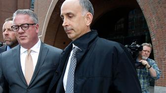 California businessman Stephen Semprevivo departs federal court Tuesday, May 7, 2019, in Boston, after pleading guilty to charges that he bribed the Georgetown tennis coach to get his son admitted to the school. (AP Photo/Steven Senne)
