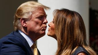President Donald Trump greets first lady Melania Trump at the conclusion of a program for the first lady's Be Best initiative, in the Rose Garden of the White House, Tuesday, May 7, 2019, in Washington. (AP Photo/Evan Vucci)