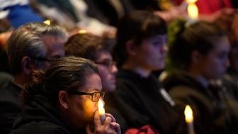 THOUSAND OAKS, CA - NOVEMBER 08: Mourners attend a vigil for the victims of the mass shooting at the Thousand Oaks Civic Arts Plaza  on November 8, 2018 in Thousand Oaks, California. Twelve people including a Ventura County Sheriff sergeant and the gunman died in the mass shooting at Borderline Bar and Grill . (Photo by Kevork Djansezian/Getty Images)