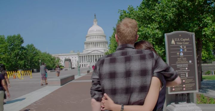 "Riley Roberts and Alexandria Ocasio-Cortez look at the U.S. Capitol building in a still from Netflix's ""Knock Down the House."