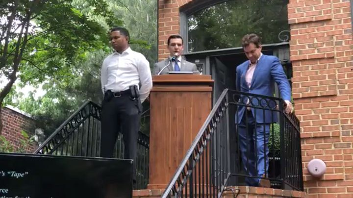 A screengrab from a Facebook livestream shows Jacob Wohl flanked by a security guard and conspiracy theorist Jack Burkman, ri