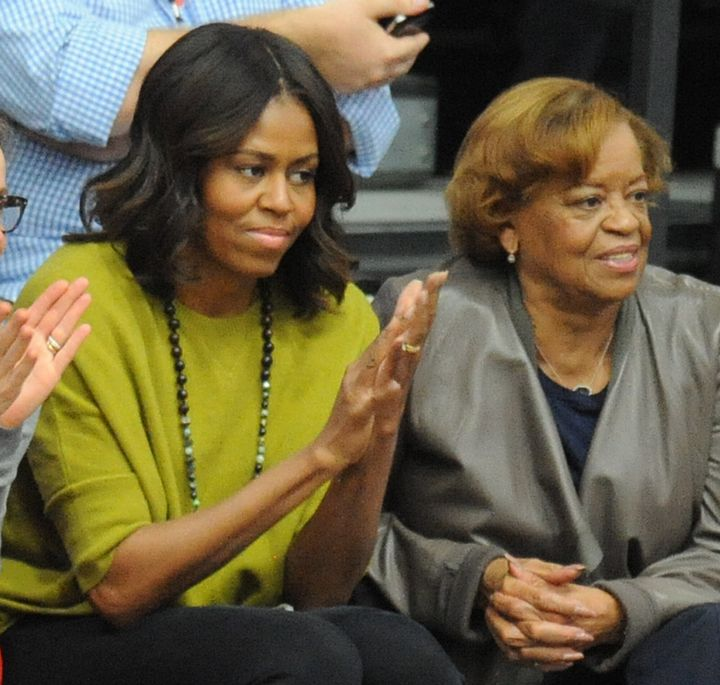 Michelle Obama watching a basketball game with her mother Marian Robinson in 2014.