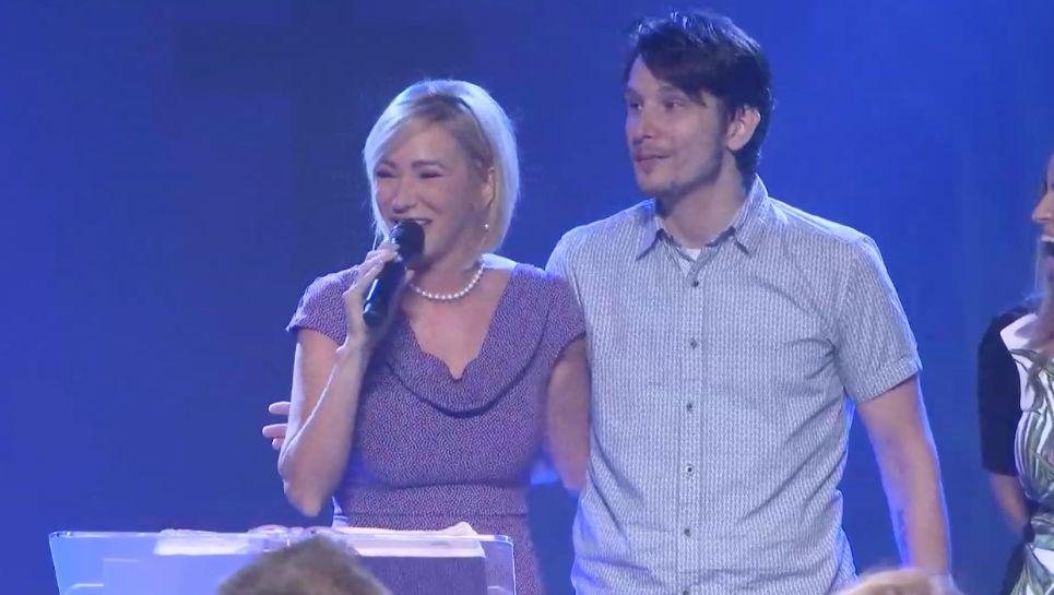 Paula White speaks atNew Destiny Christian Center, which has beenrenamed City of Destiny, with her son, Bradley K