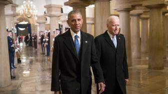 President Barack Obama and Vice President Joe Biden walk through the Crypt of the Capitol in Washington, Friday, Jan. 20, 2017, for Donald Trump's inauguration ceremony. (AP Photo/J. Scott Applewhite, Pool)