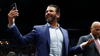 Donald Trump Jr. takes video of the crowd during a rally in Grand Rapids, Mich., Thursday, March 28, 2019. (AP Photo/Paul Sancya)