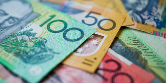 Australian money background showing $100, $50 and $20 notes with a shallow depth of