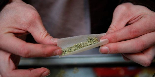 Brian Lawson rolls his marijuana cigarette at the BC Marijuana Party Headquarters in Vancouver, British...
