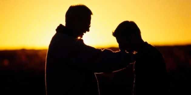 Silhouette of a father and