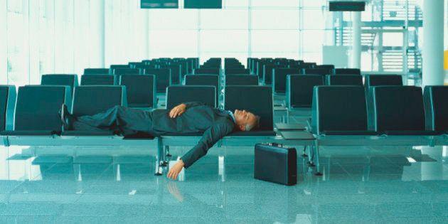 Businessman sleeping in airport