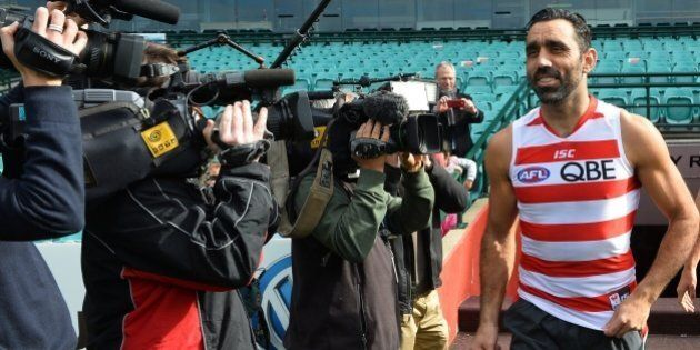 Australian Rules football star and one of Australia's most high-profile indigenous sportsmen Adam Goodes (C) arrives for training in Sydney on August 4, 2015. Goodes said he hopes to put a racism controversy behind him in announcing his return to the game after being humbled by an outpouring of support received after persistent booing of him in recent games was slammed as racist. AFP PHOTO / Peter PARKS  IMAGE STRICTLY FOR EDITORIAL USE - STRICTLY NO COMMERCIAL USE        (Photo credit should read PETER PARKS/AFP/Getty Images)