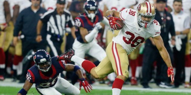 HOUSTON, TX - AUGUST 15: Jarryd Hayne #38 of the San Francisco 49ers breaks the tackle attempt of Rahim...