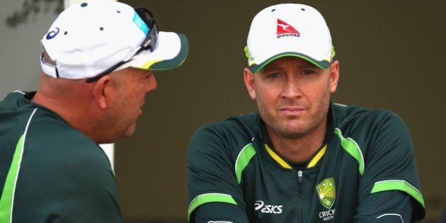 NOTTINGHAM, ENGLAND - AUGUST 08: Australian coach Darren Lehmann and Michael Clarke of Australia talk...