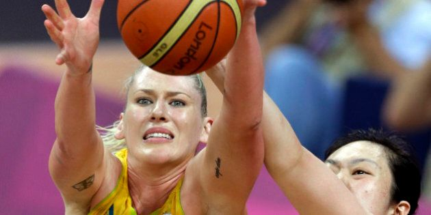 FILE - In this Aug. 7, 2012 file photo, China's Gao Song, right, tries stop Australia's Lauren Jackson...