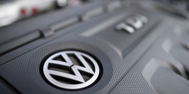 This picture taken on October 15, 2015 in Cardiff shows a Volkswagen logo on the engine of a diesel car. The German authorities tightened the screws on Volkswagen today, saying they would order it to recall 2.4 million vehicles across the country that are fitted with pollution-cheating software.  AFP PHOTO / DAMIEN MEYER        (Photo credit should read DAMIEN MEYER/AFP/Getty Images)