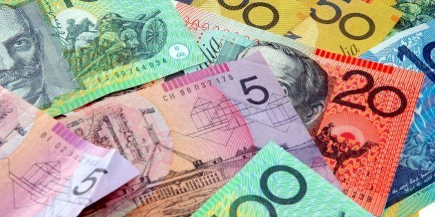 Australian notes scattered on a table. Click to see