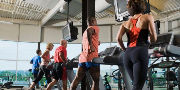 Men and women running on treadmills