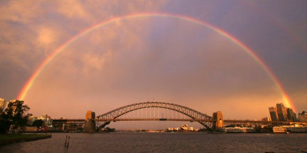 A rainbow forms over the Harbour Bridge on a wet day in Sydney Wednesday, June 17, 2015. (AP Photo/Rick