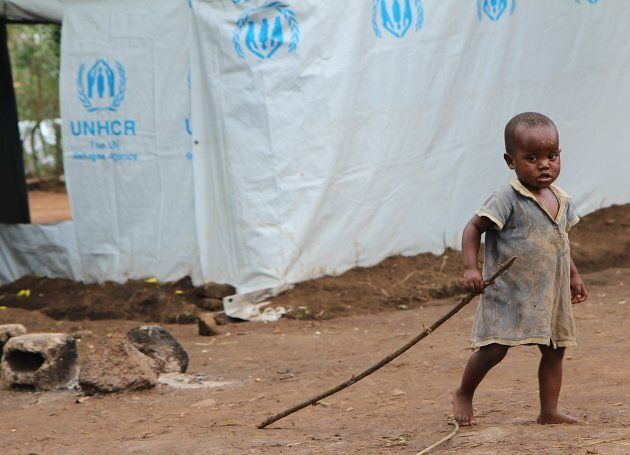 A Burundian refugee child plays at the Gashora refugee camp in Rwanda. The UN estimates that 400,000...