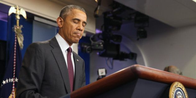 President Barack Obama pauses as he speaks in the Brady Press Briefing Room at the White House in Washington,...