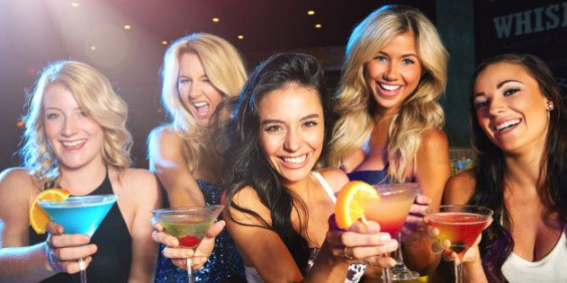 Shot of young women drinking cocktails in a