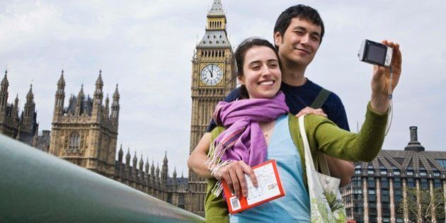 Couple posing for self portrait by Big Ben, London,