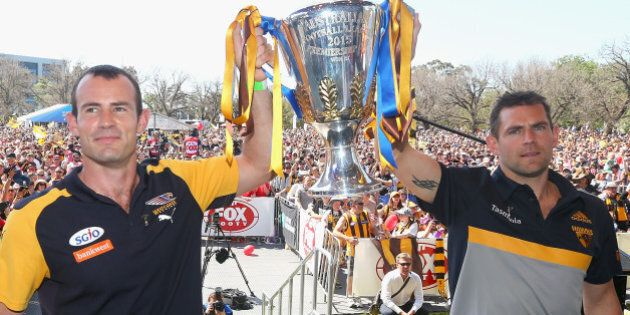 MELBOURNE, AUSTRALIA - OCTOBER 02:  Shannon Hurn the captain of the Eagles and Luke Hodge the captain of the hawks pose with the Premiership trophy during the 2015 AFL Grand Final parade on October 2, 2015 in Melbourne, Australia.  (Photo by Quinn Rooney/Getty Images)