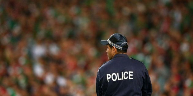 SYDNEY, AUSTRALIA - OCTOBER 05: A policeman looks on during the 2014 NRL Grand Final match between the...