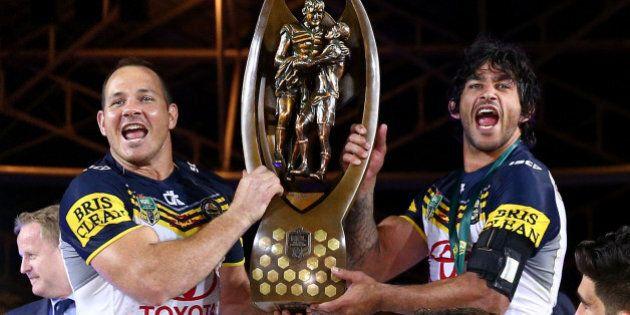 SYDNEY, AUSTRALIA - OCTOBER 04: Matthew Scott of the Cowboys and Johnathan Thurston of the Cowboys hold...