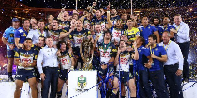SYDNEY, AUSTRALIA - OCTOBER 04: The Cowboys celebrate on the podium with the premiership trophy after...
