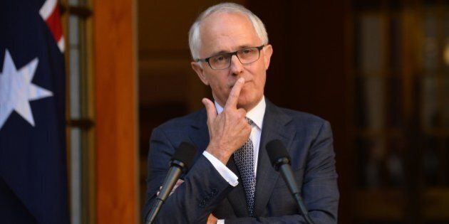 New Australian Prime Minister Malcolm Turnbull ponders a question after announcing his new cabinet at...