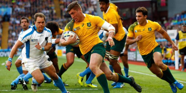BIRMINGHAM, ENGLAND - SEPTEMBER 27: Sean McMahon of Australia runs in to score his side's first try during...