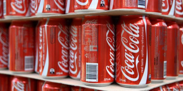 Empty Coca-Cola Classic cans stand ready for filling at Coca-Cola Amatil Ltd.'s production facility in...