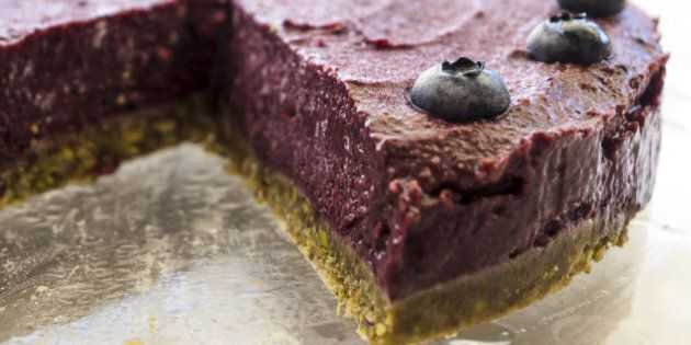 Delicious raw cake. The base is made of pistachio and almonds and the cream of avocado, blueberries, raspberries and coconut fat.