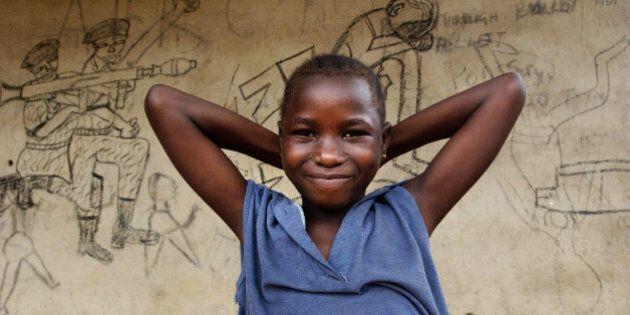 KENEMA, SIERRA LEONE - JULY 22: (FEATURE STORY - CONFLICT IN AFRICA 4 OF 7) A Sierra Leonian girl stands...