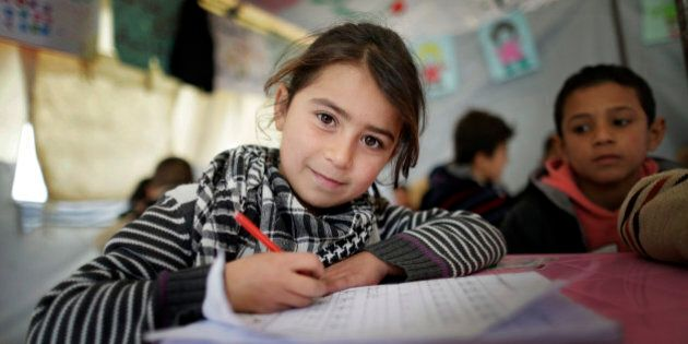ZAHLE, LEBANON - DECEMBER 09: Girl at a provisional elementary school of an informal tented settlement of Syrian refugees on December 09, 2014 in Zahle, Lebanon. The ongoing civil war in Syria continues to force masses of Syrians into neighboring Lebanon. (Photo by Thomas Koehler/Photothek via Getty Images)