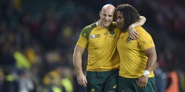 Australia's hooker Stephen Moore (L) celebrates with Australia's hooker Tatafu Polota-Nau (R)  after winning a Pool A match of the 2015 Rugby World Cup between Wales and Australia at Twickenham Stadium, southwest London, on October 10, 2015.AFP PHOTO / MARTIN BUREAURESTRICTED TO EDITORIAL USE, NO USE IN LIVE MATCH TRACKING SERVICES, TO BE USED AS NON-SEQUENTIAL STILLS        (Photo credit should read MARTIN BUREAU/AFP/Getty Images)