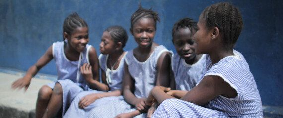 Aussies Don School Dresses For Girls' Education In Sierra