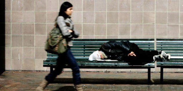 Ausralia, Sydney, homeless man sleeping on a bench,