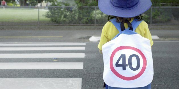 Students at Junction Park State School were handed 40km speed sign backpacks as school holidays