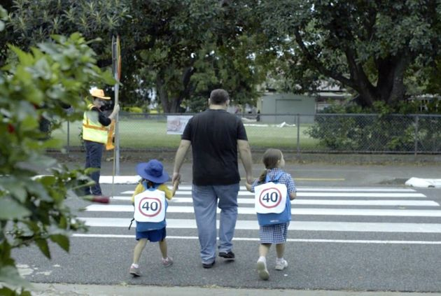 Road Safety Campaign: Children Wear 40km Speed Sign Backpacks Around