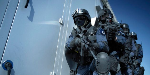 Officers of the police elite unit SWAT 'Special Weapons and Tactics' during a hostage rescue operation.