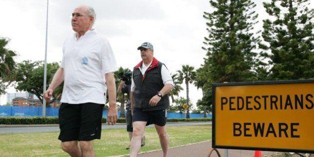 PERTH, AUSTRALIA - OCTOBER 26: Australian Prime Minister John Howard takes an early morning walk along...